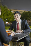 Business People Working While Having Dinner Royalty Free Stock Images