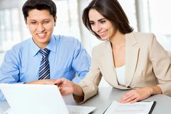 Business people working with laptop. In an office Royalty Free Stock Images