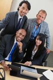 Business people working on laptop together Royalty Free Stock Photo