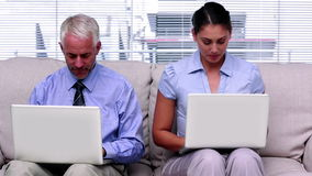 Business people working on laptops Stock Photos