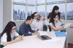 Business people working in a meeting room.  Stock Photo
