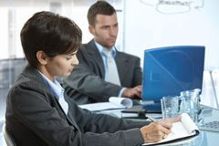 Business people working at meeting table Royalty Free Stock Photos