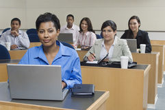 Business People Working In Office. Portrait of multi ethnic business people working in office Royalty Free Stock Photo