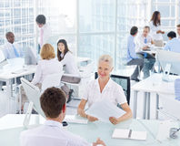 Business People Working in an Office Royalty Free Stock Images