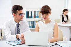 Business people working in an office. Business people working with computer in an office Royalty Free Stock Images