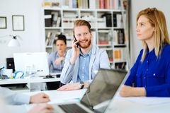 Business people working in office. And collaborating Stock Image