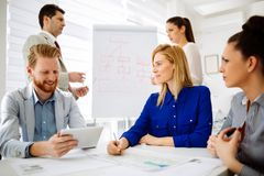 Business people working in office. And collaborating Royalty Free Stock Photos