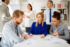 Business people working in office. And collaborating Stock Photography