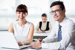 Business people working in an office. Business people working with computer in an office Royalty Free Stock Photo