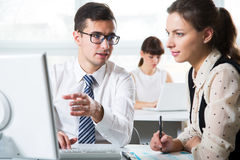 Business people working in an office Stock Images