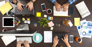 Business People Working on an Office Desk Stock Photography