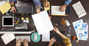 Business People Working on an Office Desk Royalty Free Stock Image