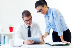 Business people working in the office with digital tablet. Royalty Free Stock Images