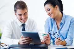 Business people working in the office with digital tablet. Royalty Free Stock Photos