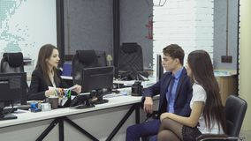 Business people working in office. Good deal. Team of businessmen - two young women and man in formal attire sign contract for successful transaction during stock video