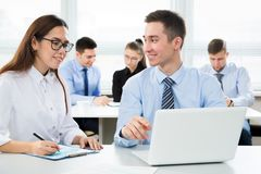 Business people working in an office. Business people having meeting in modern office Stock Photos