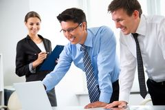 Business people working in an office. Business people working with laptop in an office stock photography