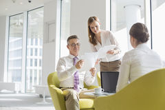 Business people working at office lobby Stock Images