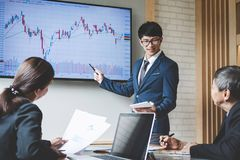 Business people are working in office, presentation in front of. Boss, businessman leader presentation to colleagues and business strategy and pointing to the stock image
