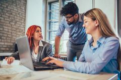 Business people working in office together. Team work in office Royalty Free Stock Photo