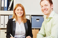 Business people working in office. Two happy business people working in office Royalty Free Stock Photography