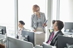 Business people working in an open plan office Stock Photo
