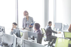 Business people working in open plan office Royalty Free Stock Photo