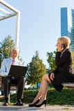 Business people working outdoors Royalty Free Stock Images