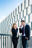 Business people working outdoors in city Royalty Free Stock Photo