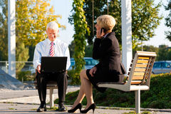 Business people working outdoors Stock Images