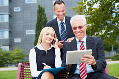 Business people working outside Stock Images