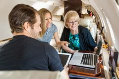 Business People Working In Private Jet Stock Image