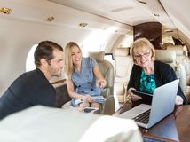 Business People Working In Private Jet Royalty Free Stock Image