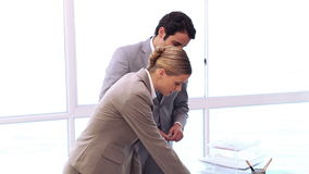 Business people working on professional documents. In an office stock video