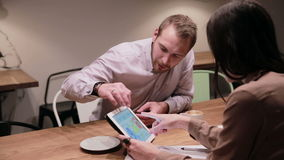 Business people working with tablet in cafe stock footage