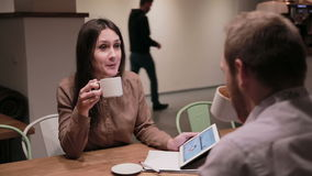 Business people working with tablet in cafe. Business people working with documents and tablet in cafe stock footage