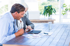 Business people working on tablet computer Royalty Free Stock Photography