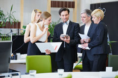 Business people working with tablet PC in office Stock Images