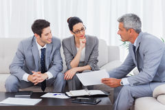 Business people working and talking together on sofa Stock Image