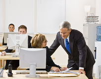 Business people working together. At a computer Stock Photos