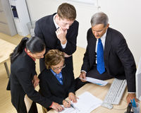Business people working together. At a desk Stock Photos