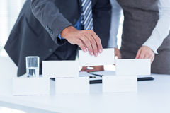 Business people working together and building structure. In an office stock photos