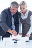 Business people working together and building structure. In an office stock images
