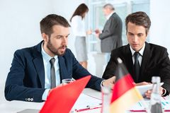 Business people working together. The business people working together at table. The meeting or summit concept Royalty Free Stock Images