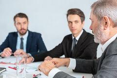 Business people working together. The business people working together at table. The meeting or summit concept Royalty Free Stock Photography