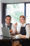 Business people working together in a cafe Stock Images