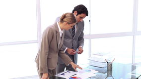 Business people working together on charts. In a bright office stock video footage