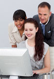 Business people working together at a computer Stock Photos