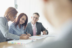 Business people working together at conference table Royalty Free Stock Images