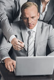 Business people working together. Group of business people working together with laptop at meeting Royalty Free Stock Image